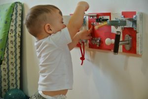 how to put busyboard safely for toddler
