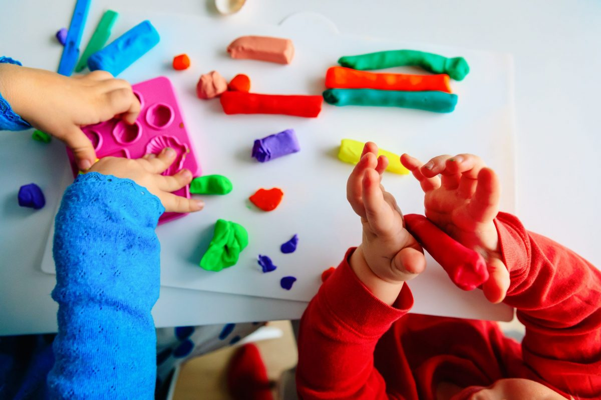 gender-neutral play two toddlers hands wiith play-doh