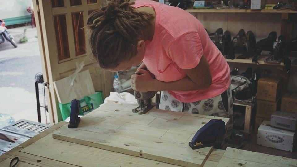 woman making a busy board woodworking project