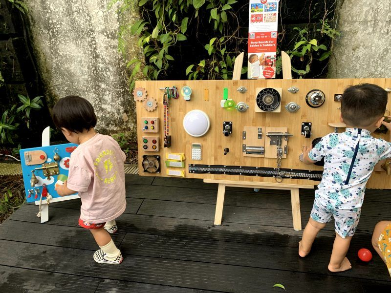 babies and toddlers playing with easy busy boards in Vietnam